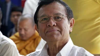 Photo of Cambodian opposition leader goes on trial for 'treason'